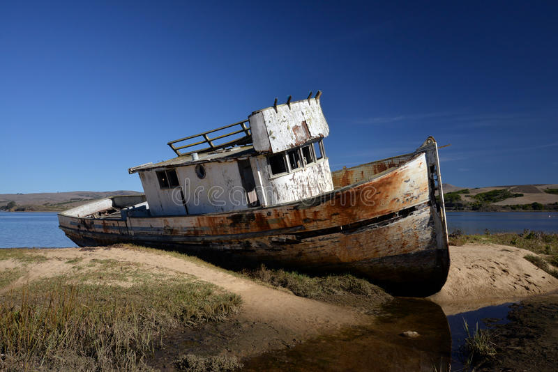 Abandoned shipwreck in the bay. Abandoned shipwreck in Tomales Bay, CA stock photo