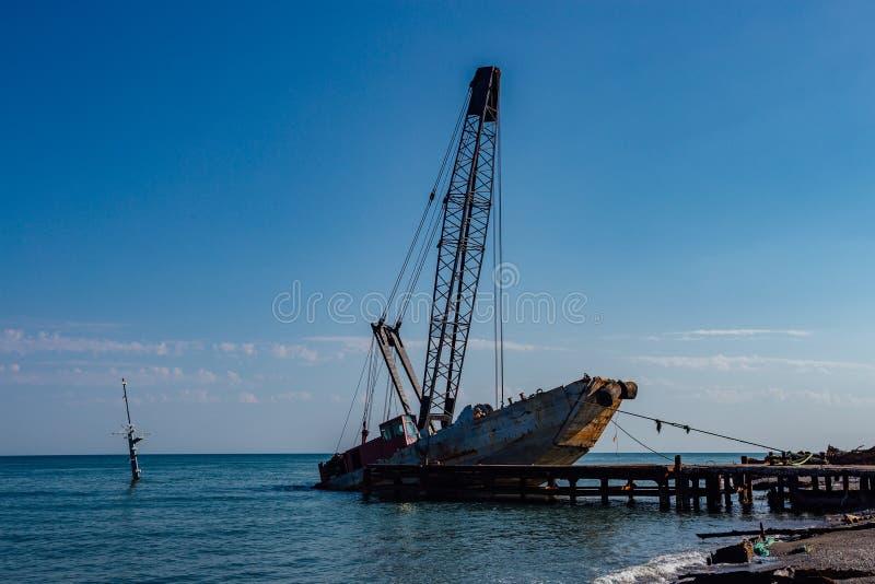 Abandoned shipwreck on black sea coast in Abkhazia.  stock photography