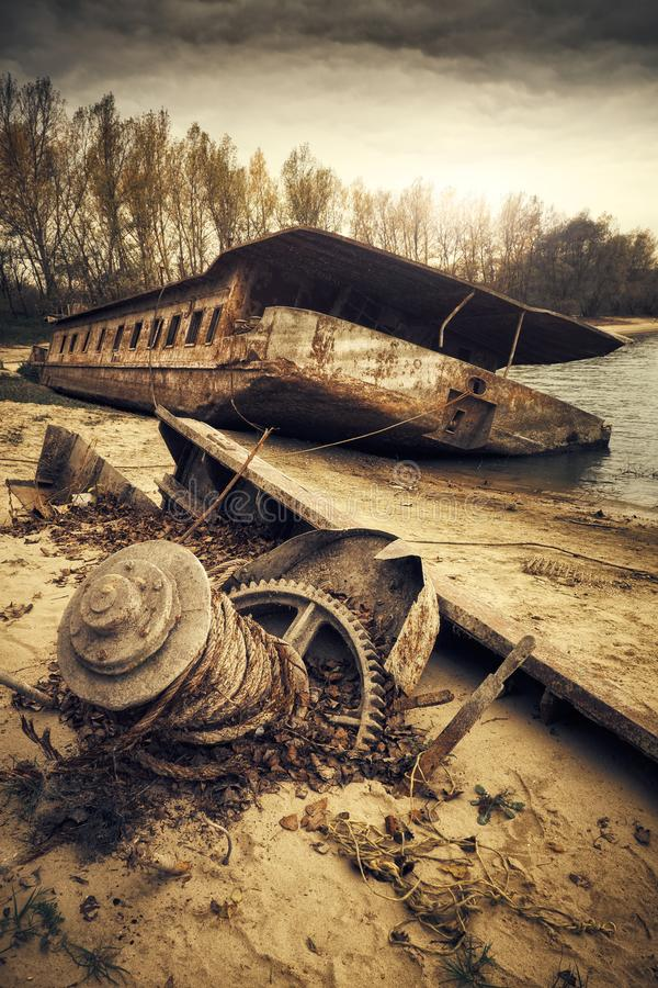 Abandoned shipwreck. Photo of an Abandoned shipwreck on the shore stock photos