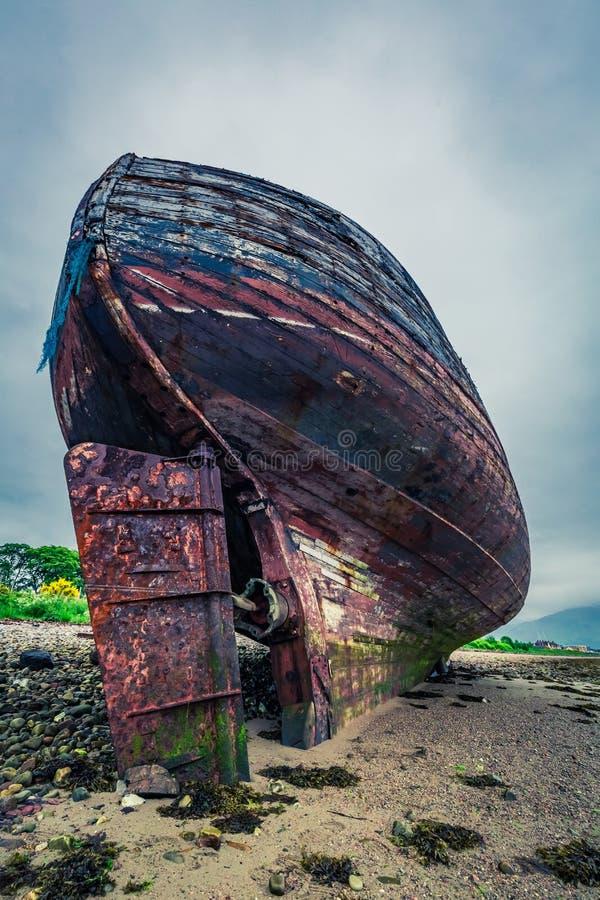 Abandoned shipwreck on shore in Fort William, Scotland, United Kingdom. Europe stock photography