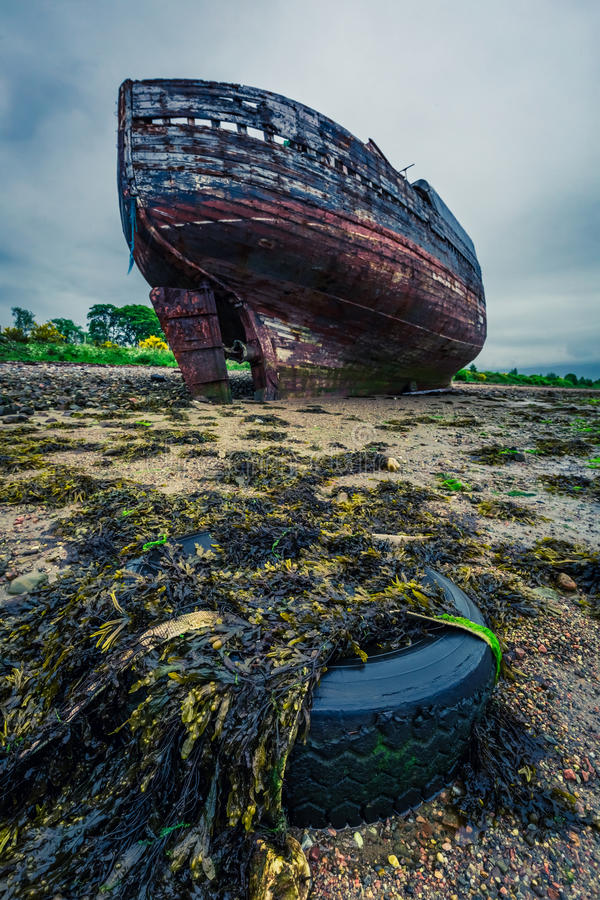 Abandoned shipwreck on shore in Fort William in summer, Scotland. Europe stock image