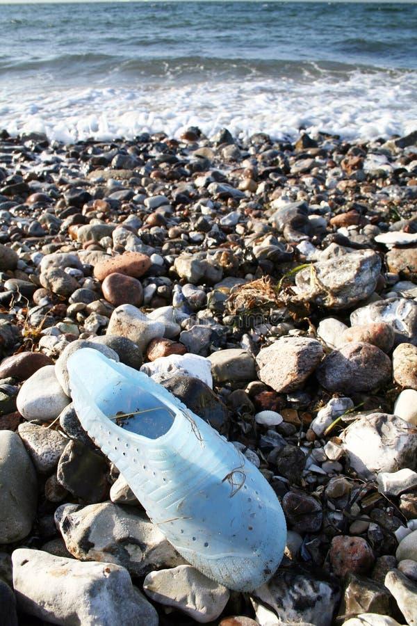 Abandoned shoe on beach royalty free stock photo