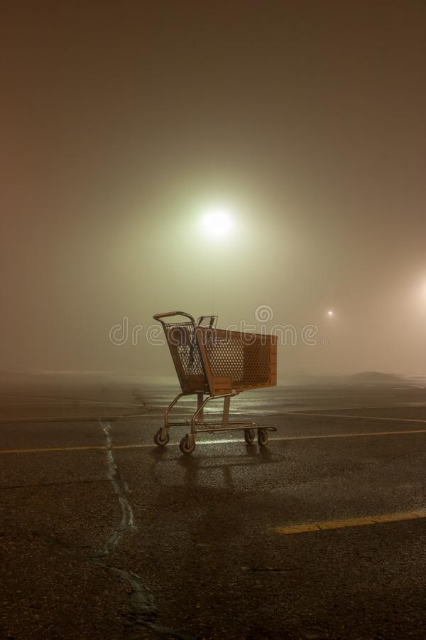 Abandoned shopping cart on an eerie spring evening in Ann Arbor, Michigan royalty free stock photo