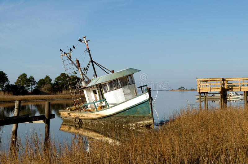 Abandoned shrimp boat, Florida stock images