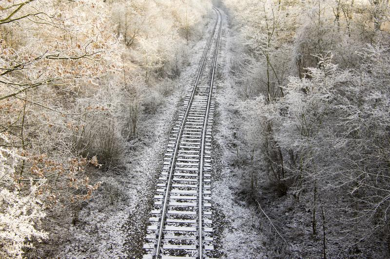 Abandoned single track railway line in sunny freezing weather royalty free stock photos