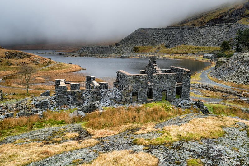 Abandoned Slate Quarry in Wales. Derelict miner`s cottages at the abandoned Cwmorthin Slate Quarry at Tanygrisiau in north Wales royalty free stock image