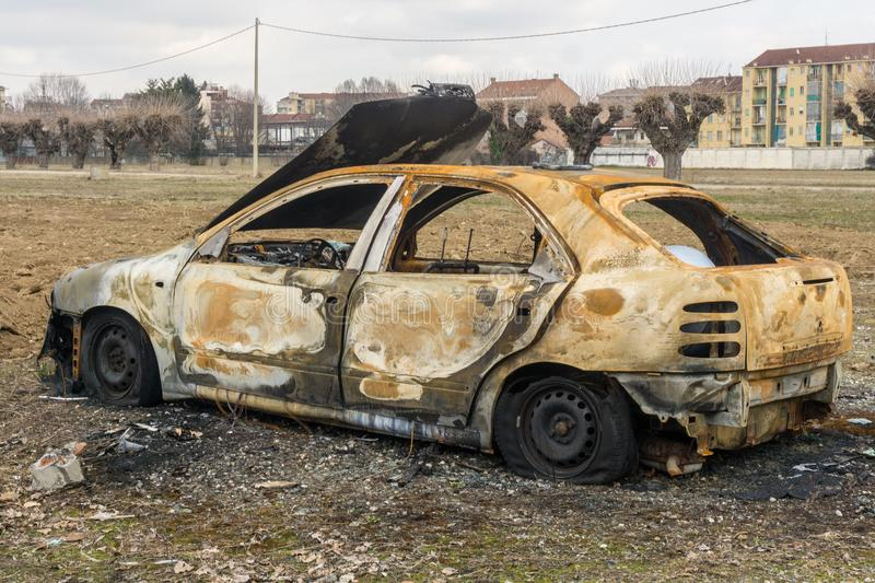 An abandoned, stolen burnt out car royalty free stock photography