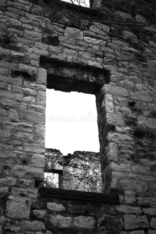 Abandoned Stone Building. Black and white image of a ruined stone building stock image