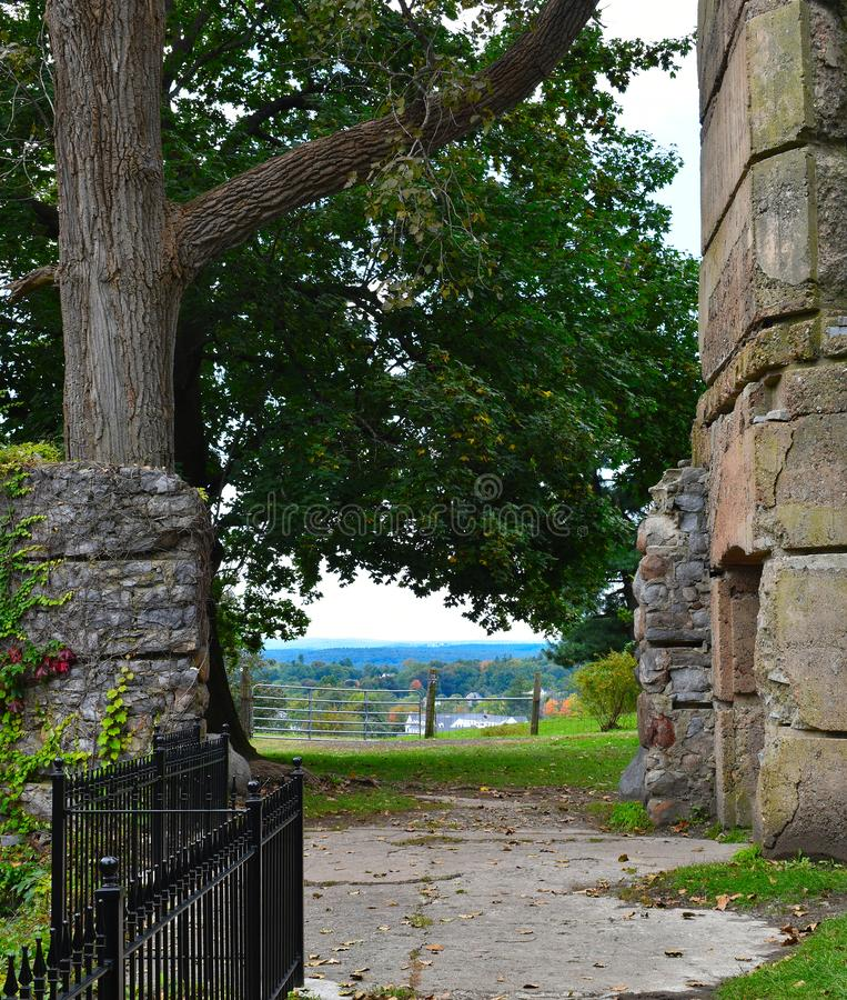 Abandoned stone castle overlooking the town of Groton, Massachusetts, Middlesex County, United States. New England Fall. Abandoned stone castle and surrounding royalty free stock photo