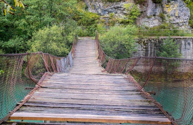 Abandoned suspension bridge at Slovenia and Croatia border. Morning time stock photography