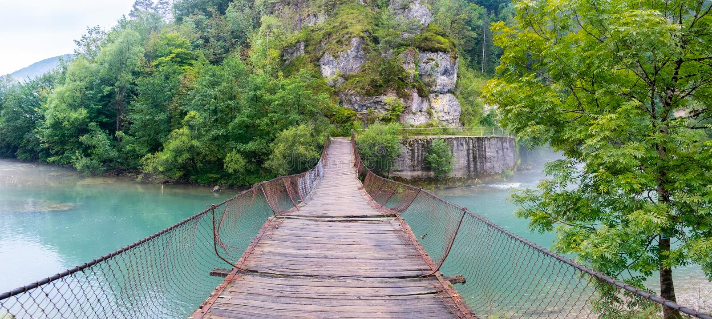 Abandoned suspension bridge at Slovenia and Croatia border. Morning time stock images