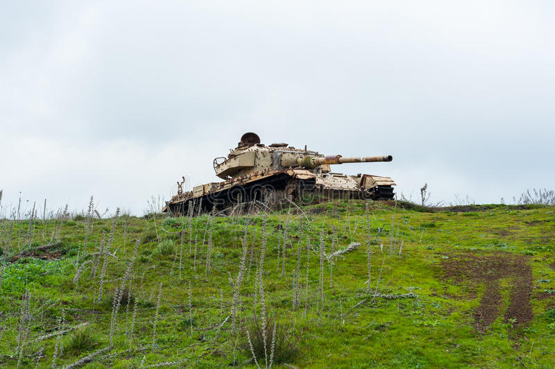 Abandoned tank. Old abandoned Syrian tank standing still on a hill on the Golan Heights in northern Israel. The tank was probably part of an operation during the stock photos