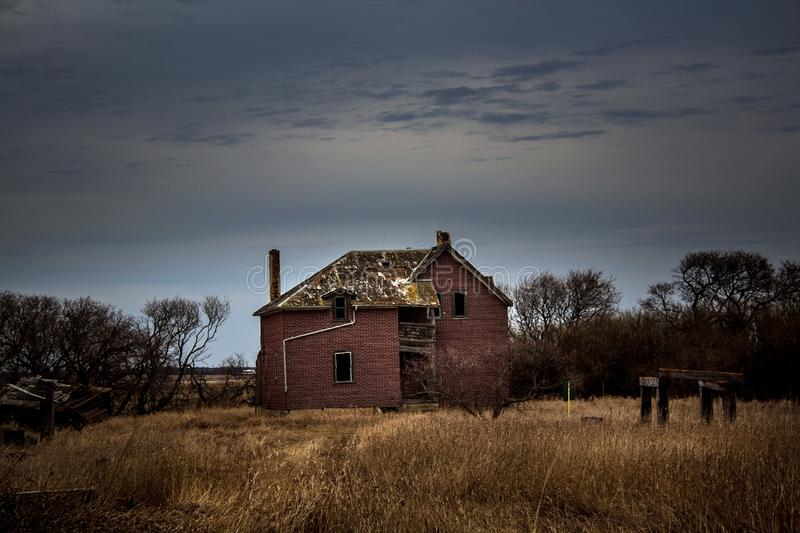 Abandoned turn of the century homestead. Turn of the century homestead, abandoned but still full of character and intrigue royalty free stock photography