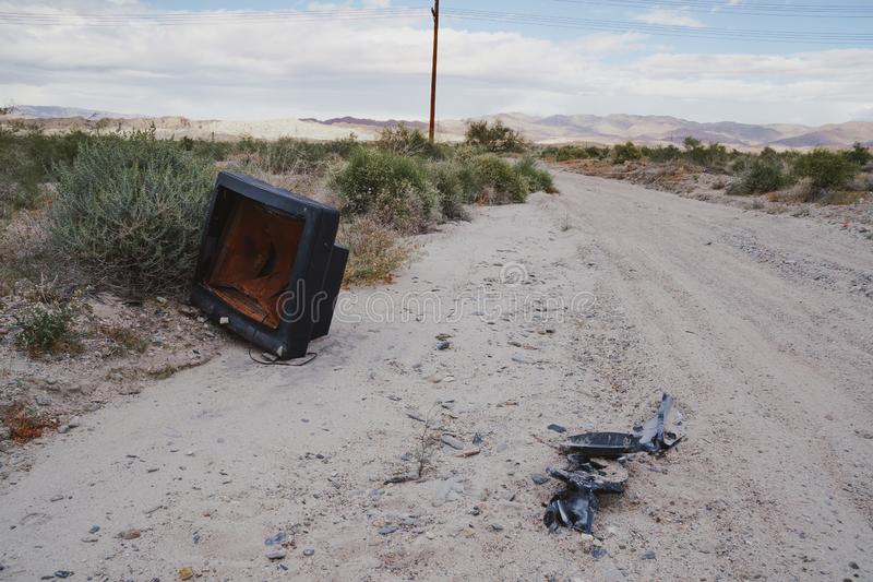 Abandoned TV left to rot in the middle of the California desert, taken near the Salton Sea stock image
