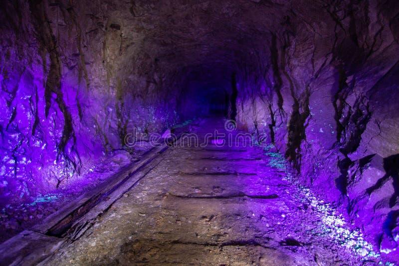 Abandoned uranium mine illuminated by ultraviolet light.  royalty free stock image
