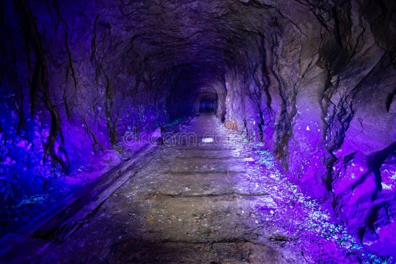 Abandoned uranium mine illuminated by ultraviolet light.  stock photos