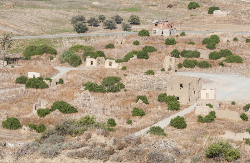 Abandoned village with deserted and collapsed houses. Aerial view of the abandoned village of Agios Sozomenos with deserted and collapsed clay houses in Cyprus royalty free stock image