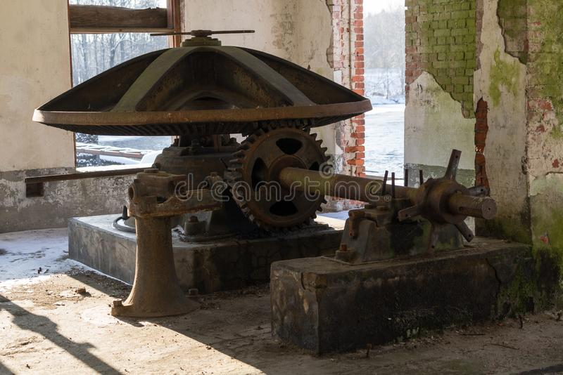 Abandoned water mill. Rusty iron wheel natural background. royalty free stock images