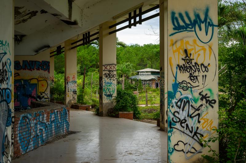 Abandoned water park, Hue. Old devastated building in old water park complex near to Vietnam town Hue. On the wall are color graffiti stock photos