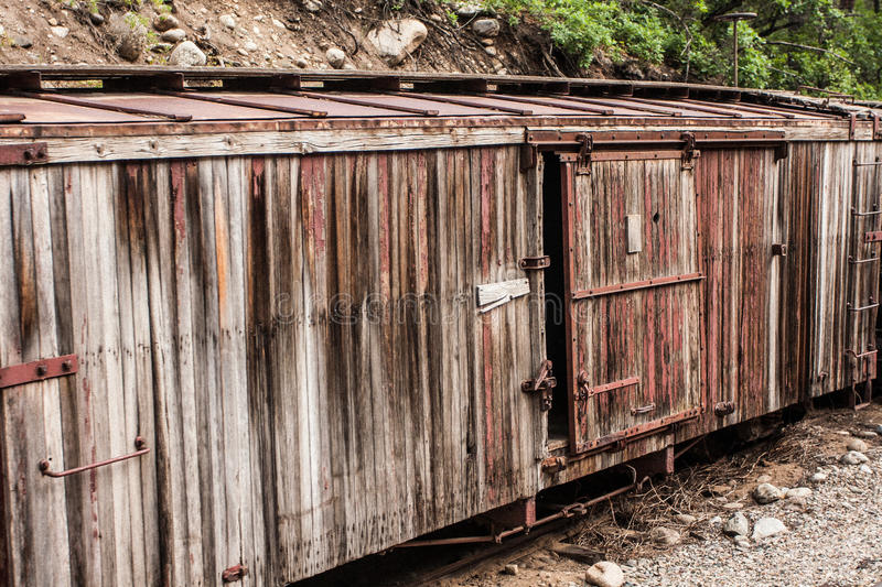 Abandoned, Weathered Boxcar. Old, abandoned, weathered and faded boxcar beside the Durango-Silverton narrow gauge railroad line, Colorado royalty free stock images