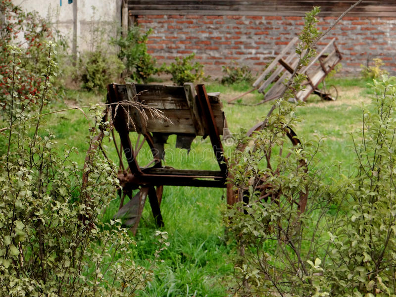 Abandoned wheel chair. Old abandoned wheel chair in a back garden stock photography