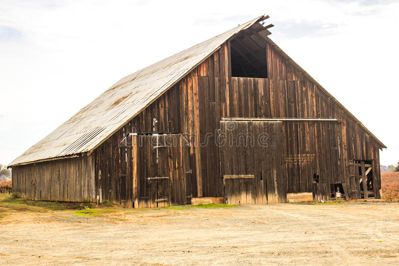 Abandoned Wood Barn With Tin Roof stock image