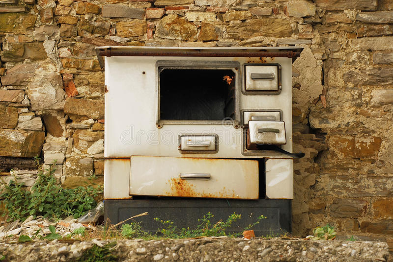 Abandoned Wood Burning Cooker. An old abandoned wood burning cooker, left in a street in Smartno, Slovenia royalty free stock photos