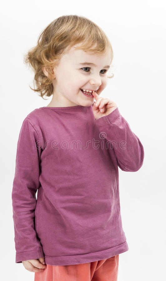 Abashed young girl in light grey background stock photos