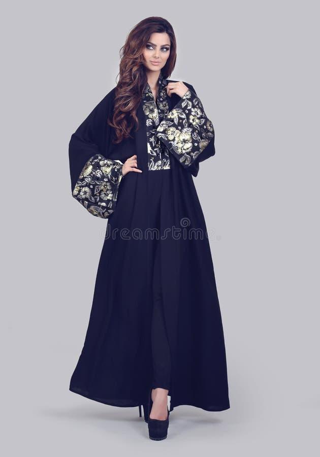 Abaya. Super model modeling for traditional Abaya dresses stock image