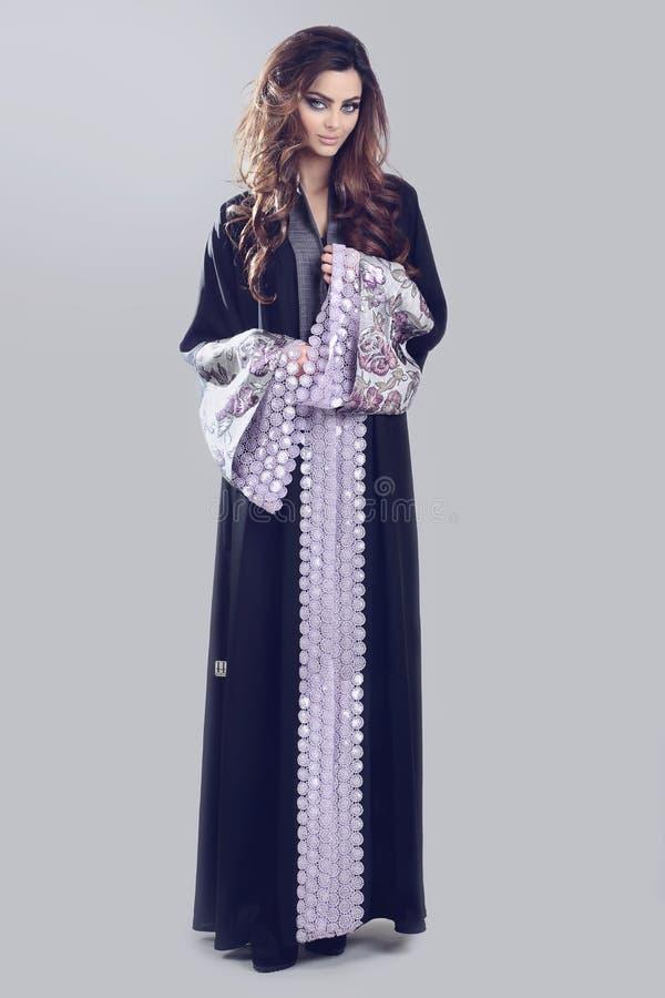 Abaya. Super model modeling for traditional Abaya dresses stock photography