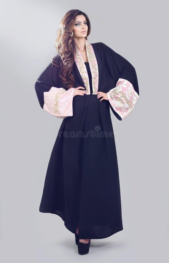 Abaya. Super model modeling for traditional Abaya dresses stock images