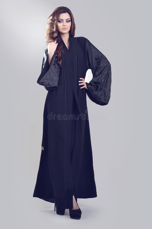 Abaya. Super model modeling for traditional Abaya dresses stock photo
