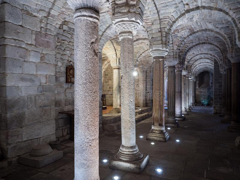 Crypt of a medieval abbey with carved stone columns royalty free stock photos