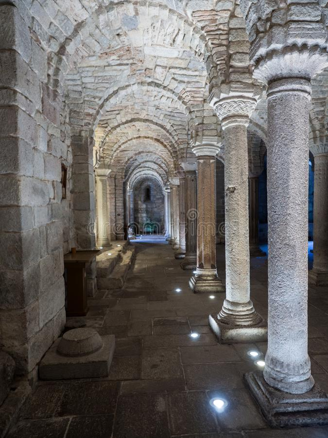 Crypt of a medieval abbey with carved stone columns stock image