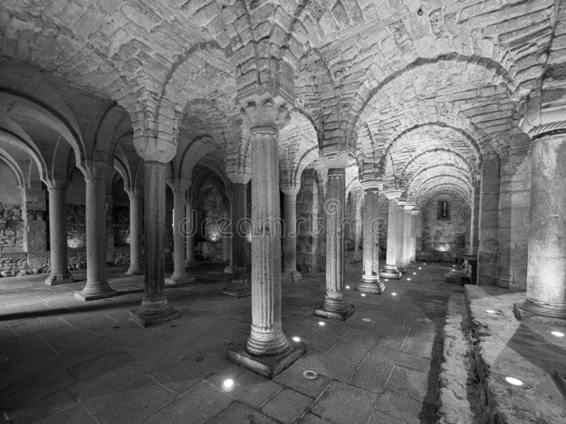 Crypt of a medieval abbey with carved stone columns stock photos