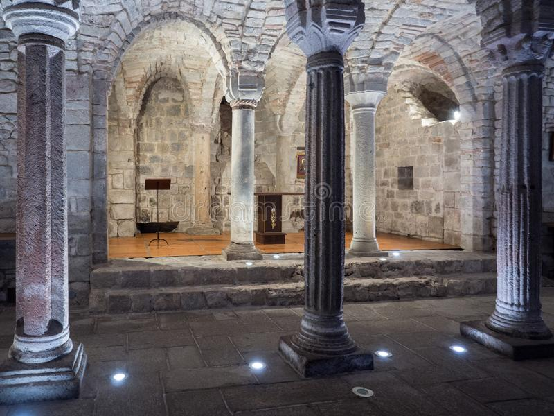 Crypt of a medieval abbey with carved stone columns stock photography