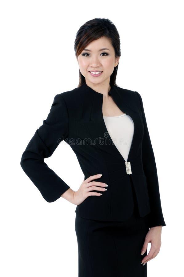 Abbastanza giovane sorridere della donna di affari immagini stock