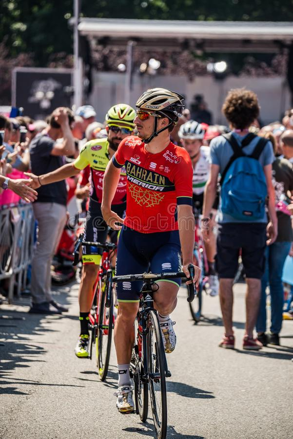 Abbiategrasso, Italy May 24, 2018: Professional Cyclist in transfer from the bus to the podium signatures. Before a hard mountain stage of the Tour of Italy royalty free stock photography