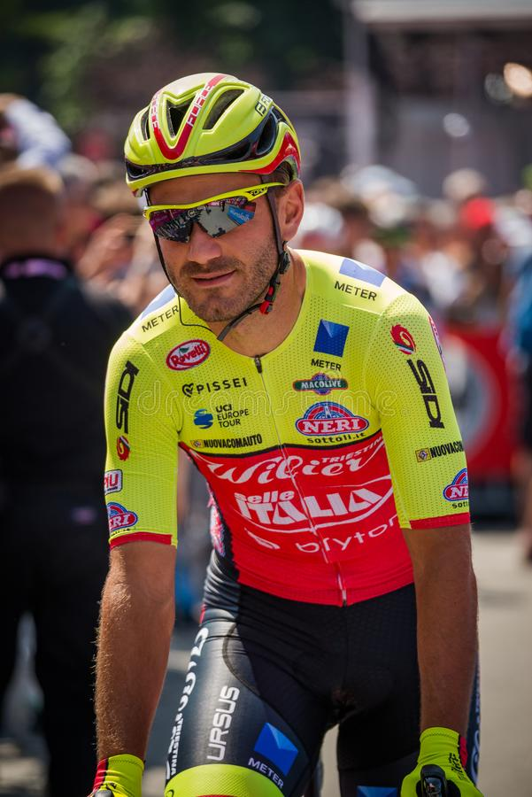 Abbiategrasso, Italy May 24, 2018: Professional Cyclist in transfer from the bus to the podium signatures. Before a hard mountain stage of the Tour of Italy royalty free stock photo