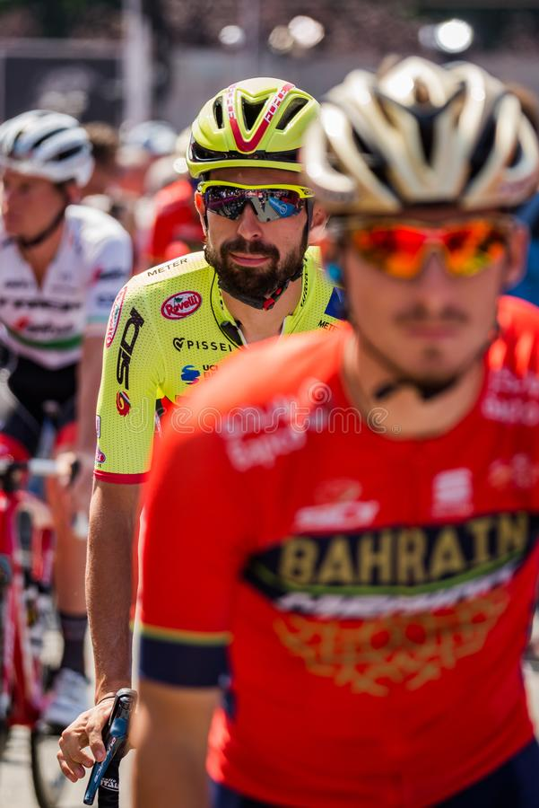 Abbiategrasso, Italy May 24, 2018: Professional Cyclist in transfer from the bus to the podium signatures. Before a hard mountain stage of the Tour of Italy stock image
