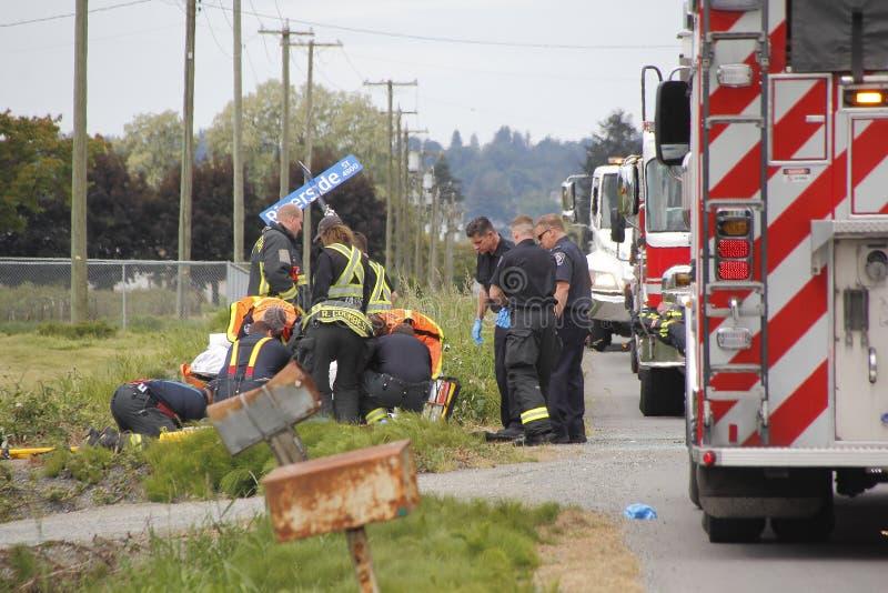 Abbotsford brand och räddningsaktionbesättningen deltar i olycka royaltyfria bilder