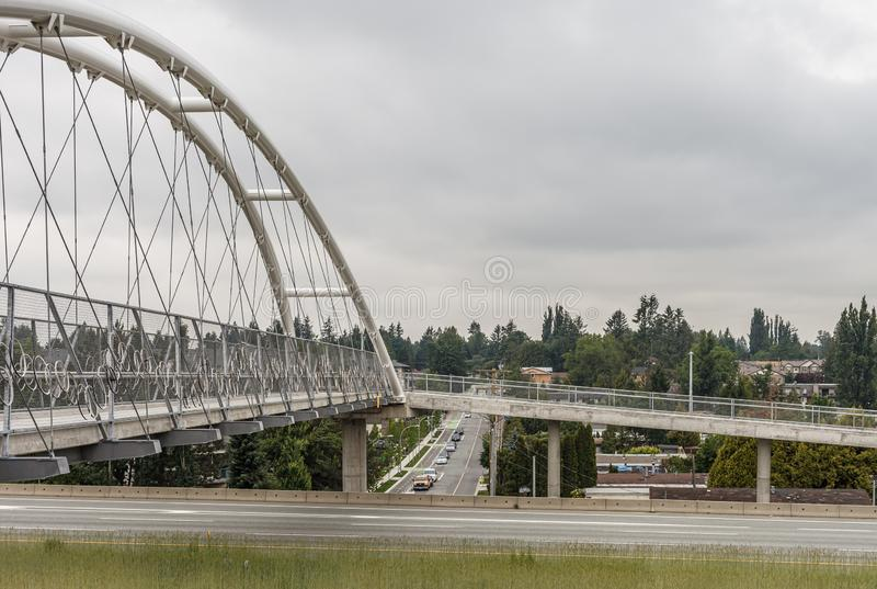 ABBOTSFORD, CANADA - MAY 29, 2019: pedestrian and bicycle bridge over the highway royalty free stock photos