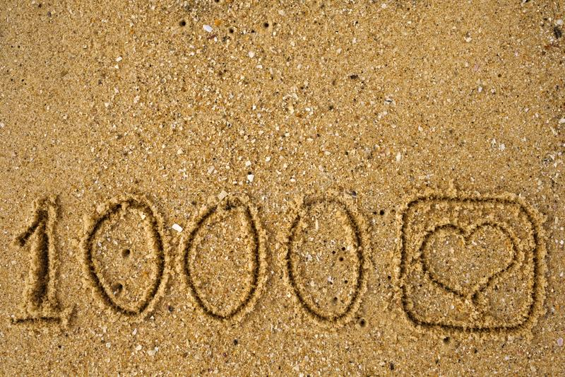 Abbottoni come volta 1.000 come una sabbia attingente fotografia stock libera da diritti