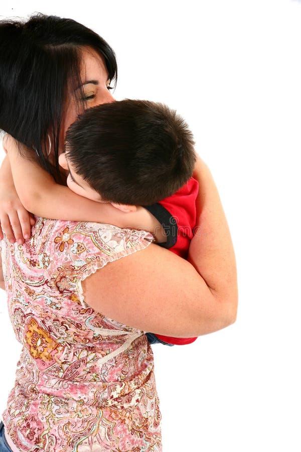 Abbracci di Momma fotografie stock libere da diritti