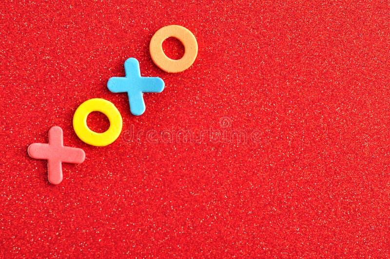 Abbracci e baci di XOXO fotografia stock libera da diritti