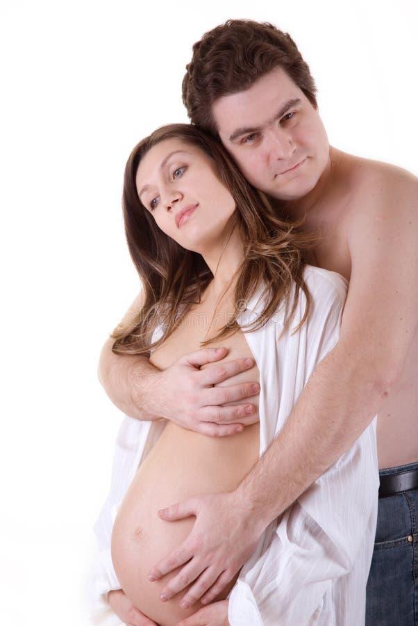 Abbraccio della gravidanza fotografie stock