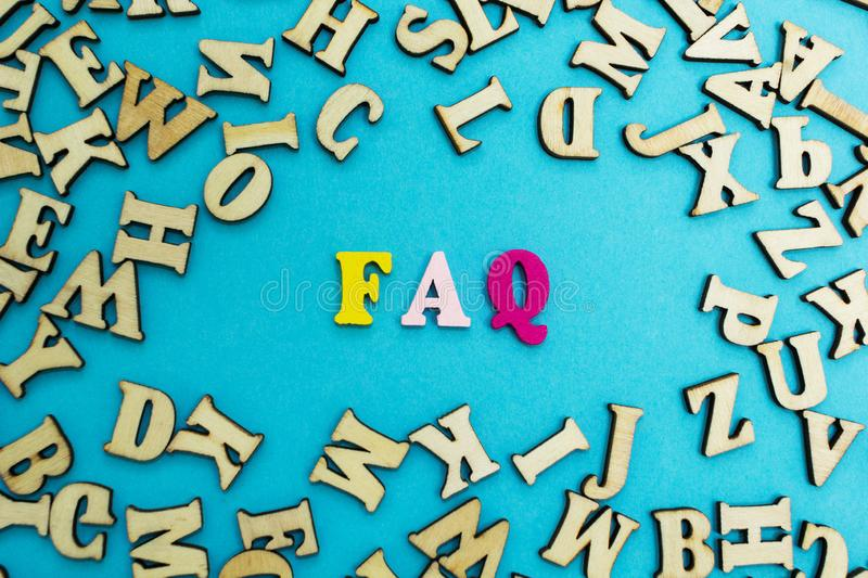 The abbreviation `faq` is laid out from multicolored letters on a blue background.  royalty free stock photos