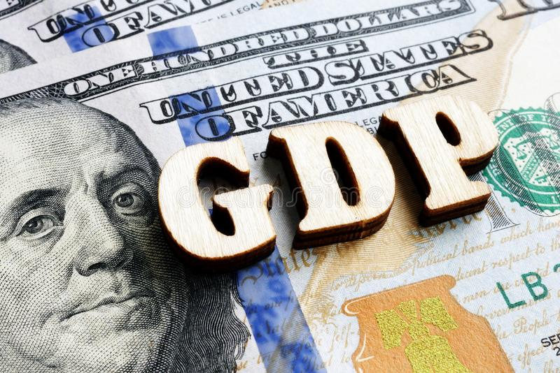 Abbreviation GDP Gross Domestic Product from wooden letters on the dollar bill. Abbreviation GDP Gross Domestic Product from wooden letters on the dollars stock image