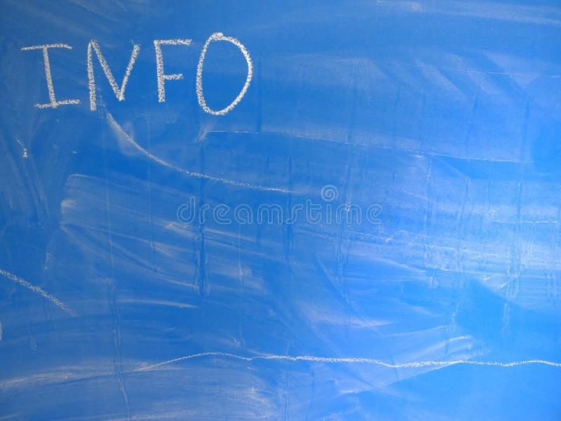 Abbreviation INFO written on a blue, relatively dirty chalkboard by chalk. Located in the upper left corner of the image making stock images