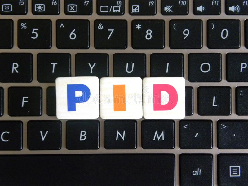 Abbreviation PID on keyboard background royalty free stock image